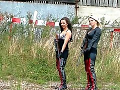 slave getting caned outside by 2 mistresses