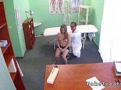 Doctor fuck brunette patient on the desk in fake hospital