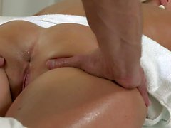 Blonde giving blowjob to masseur