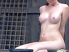 Caged angel gets a whipping for her smooth wazoo