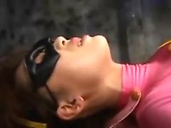 Super heroine is caught by the bad guys and gets groped and