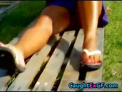 In the sun getting kinky and showing her