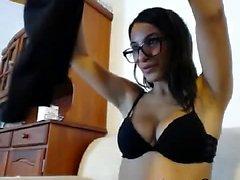Skinny brunette sucks a dildo like a cock