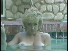 Busty blonde in a pool