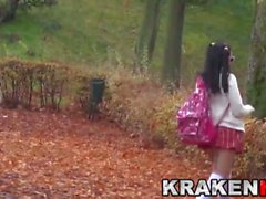 Pretty schoolgirl is provocating outdoor on the street