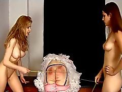 sissy caned by 2 mistresses