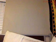 Ébano sexy brincando seu ânus na webcam