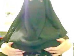 Arabian Muslim Ummah Lady in Black Burqa shows Huge Oriental Beurette Boobs