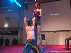 Hot redhead spanks man in front of the crowd