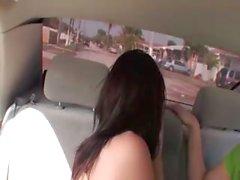 Two brunette girls sucking cock in car