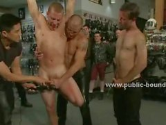 Gay rough men surprise their friends bringing in a public shop a sex slave naked in gangbang