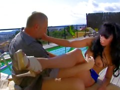 Sexy brunette gets sex by the pool