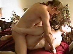 Brunette sucks cock and gets her cunt fucked in bedroom