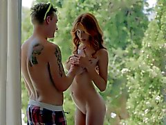 Naked young redhead Michelle gives sensual blowjob