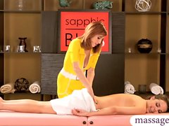 Bushy masseuse lesbosex with sexy client on massage table