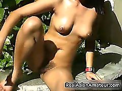 Naked Asian cutie drills her pussy