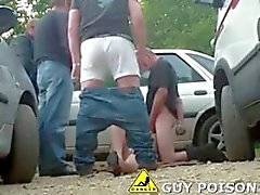 Dogging slut pleasing guys outdoor