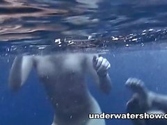 Three girls swimming nude in the sea