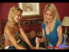 Two hot blonde MILFs do a handjob to some random guy