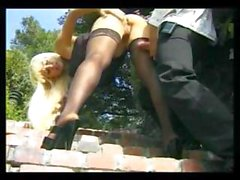 Busty blonde babe in black stockings gets drilled outside