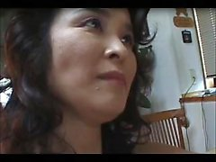 Lustful Oriental milf enjoys hot sex with a young man in th