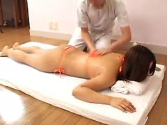 Hot Asian babe puts on a string bikini to get a sensual mas