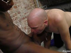 Tattooed white guy rides black cock in prison