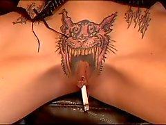 Sexy babe smokes cigarette through pussy