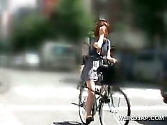 Sweet asian babes riding the bike get pussies all wet