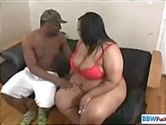 Big black BBW and skinny black dude with her eating his cock