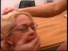 Nurse with nice tits is fucked by two businessmen in nurse's office