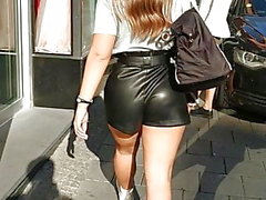 Sexy ass in leather shorts and shiny pantyhose