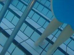 bikinis underwater at pool