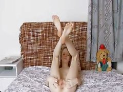 Skinny super girl opening her pussy