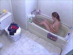 Voyeur view - teen girl masturbating in bath