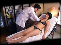 Sexy slender Oriental beauty in a tight bikini gets sensual