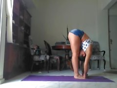 Pretty latin girl doing yoga