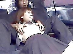 Filthy Japanese schoolgirl sucks a rod in back seat