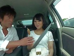 Randy guy helps brunette babe to masturbate while driving a car