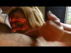 Masked Beauty sucking her lover's hard cock