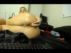 Blonde cheerleader deep toying her anus