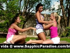 Hot brunette and blonde lesbians kisisng and getting naked in a three way lesbian orgy