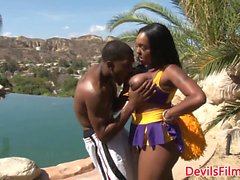 Busty black cheerleader doggystyled outdoors