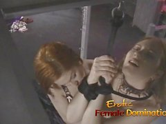Naughty slut watches as two sexy babes have fun in the dunge