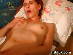 Redhead whore gets her anus fisted