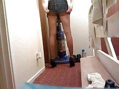 Slim crossdresser in heels, nylons, and mini skirt