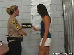 Her shoes have to come off in jail so the cop can check her toes