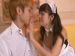Pigtailed Oriental maid exposes her big tits and seduces a