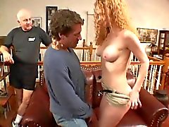 Curly-haired wife gets on her knees to suck a guys hard cock
