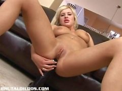 Busty blonde gapes her tight ass with a brutal dildo